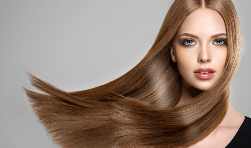 woman with windblown brunette long straight hair
