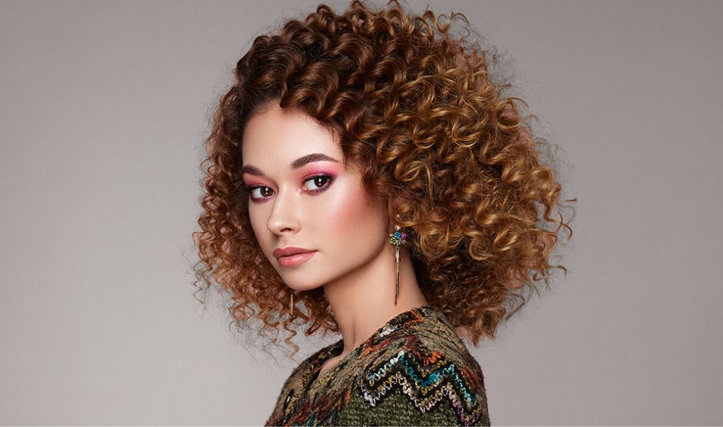 woman with kinky curly hair and pink eyeshadow