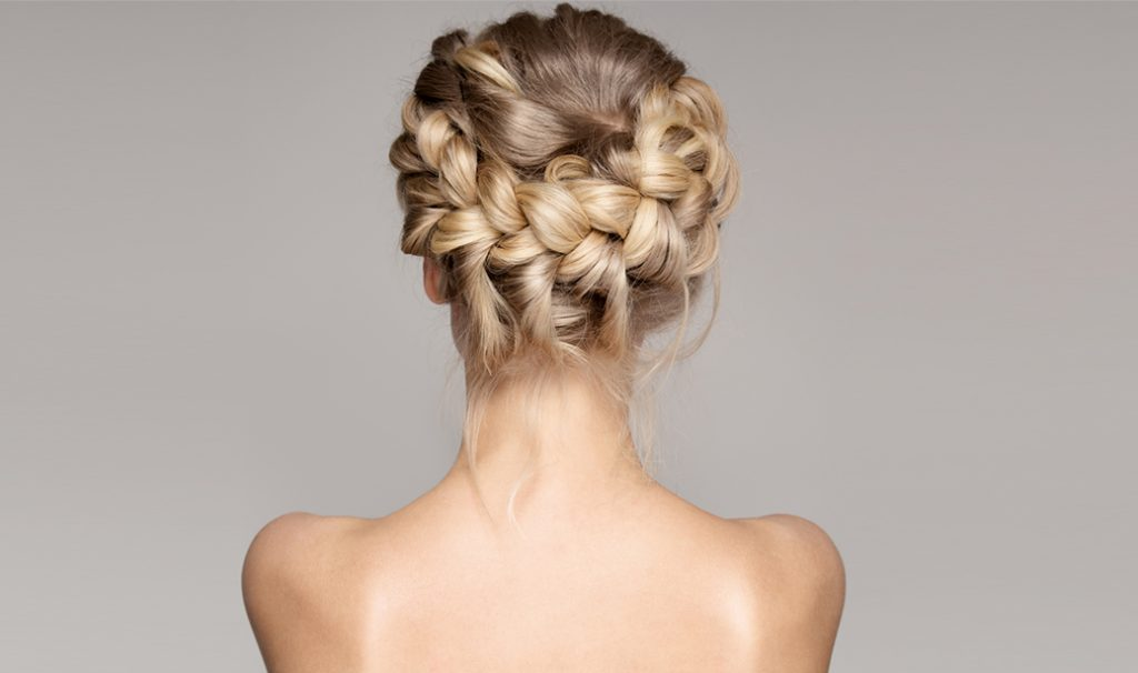 woman with blonde crown braids hairstyle showing her back