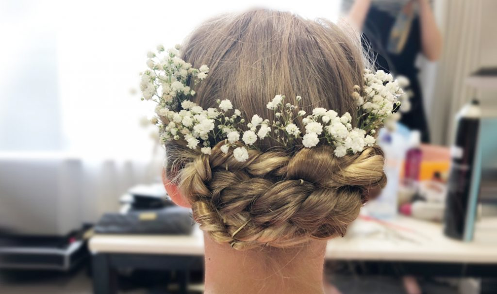 woman with bridal flower brown hairstyle