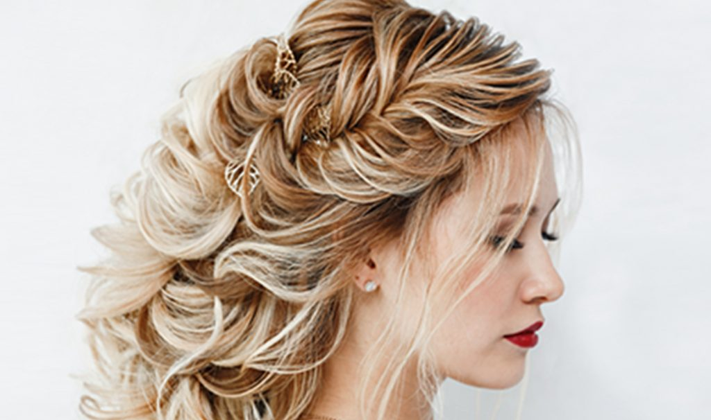 woman with blonde greek braids hairstyle