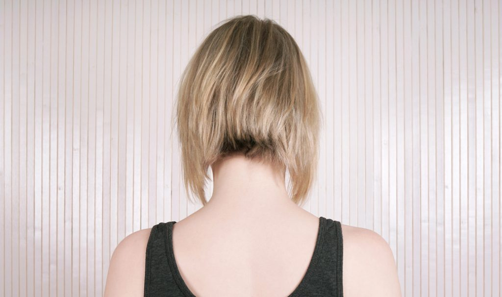 woman with lob cut hairstyle showing her back