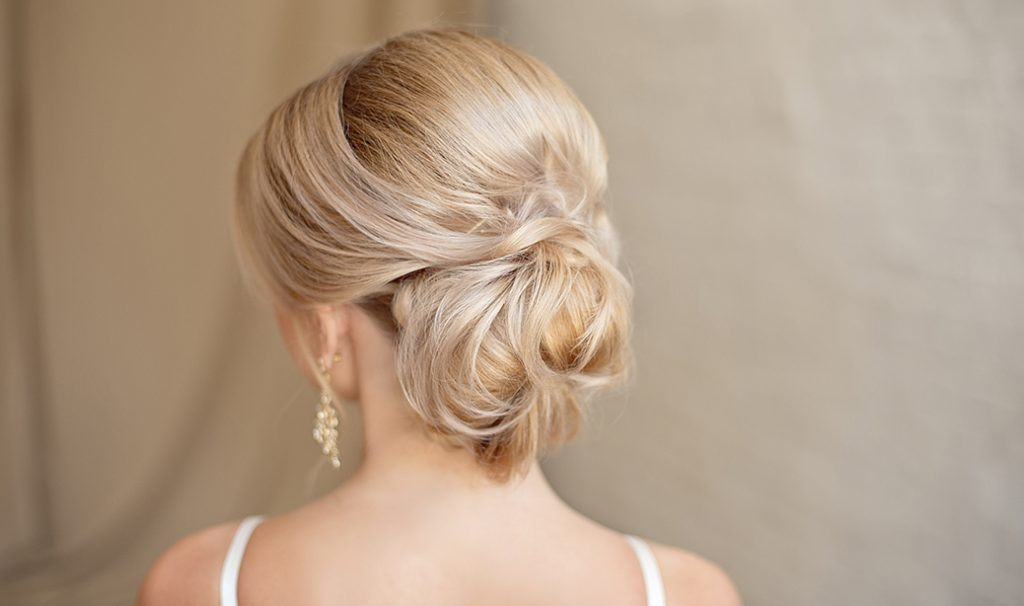 woman with blonde low bun hairstyle