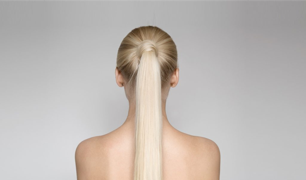 woman with long blonde ponytail showing her back