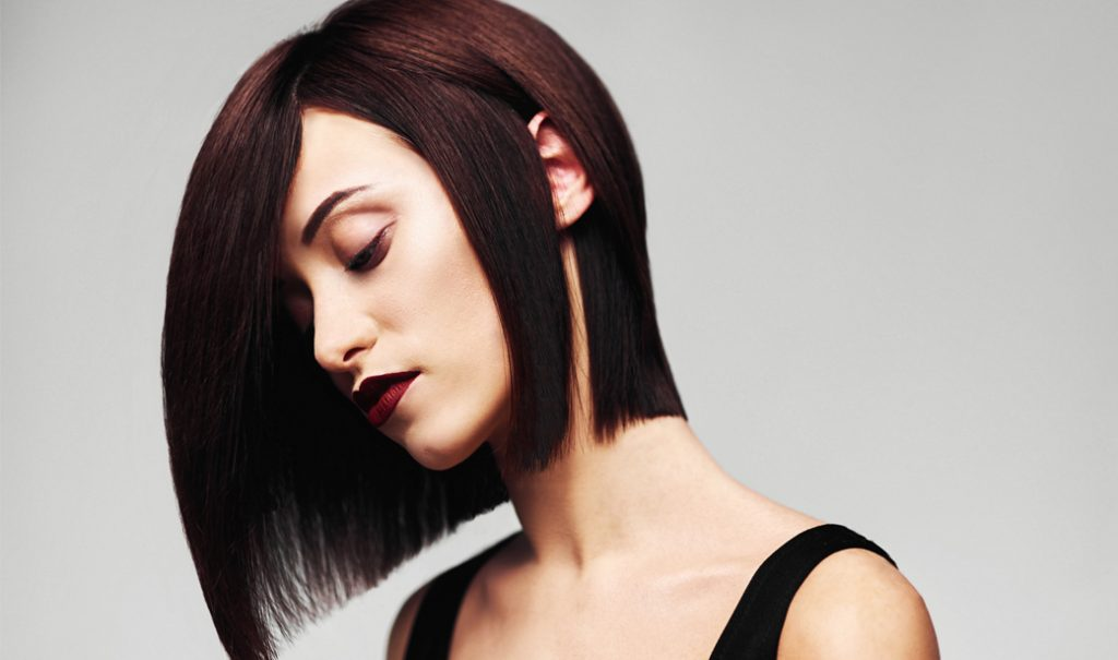 woman with brunette bob haircut looking sideways