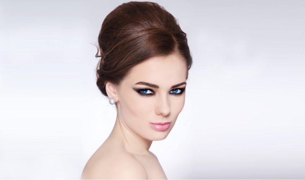 woman with blue eyes and vintage bouffant hairstyle