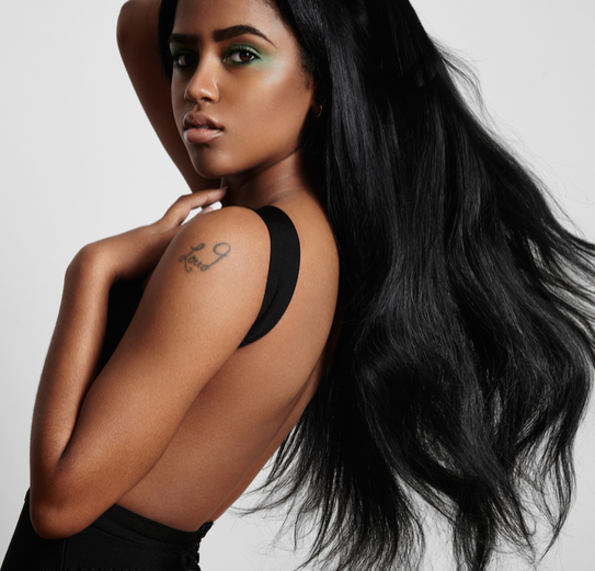 black woman from the side with a blowing hair